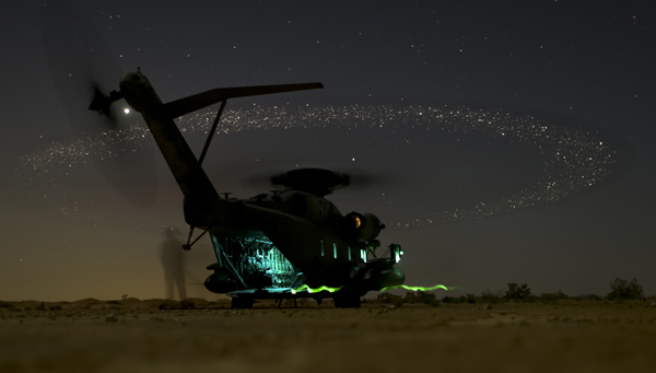 U.S. Marines assigned to Marine Aviation Weapons and Tactics Squadron One (MAWTS-1) break down a rapid ground refueling during the Weapons and Tactics Instructor Course (WTI) near 29 Palms, Calif., March 27, 2015. WTI is a seven week event hosted by MAWTS-1 cadre. MAWTS-1 provides standardized tactical training and certification of unit instructor qualifications to support Marine Aviation Training and Readiness and assists in developing and employing aviation weapons and tactics. (U.S. Marine Corps photo by Sgt. Daniel D. Kujanpaa/Released)