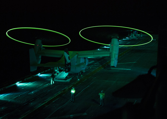 140918-N-WY954-005 ARABIAN GULF (Sept. 18, 2014) An MV-22 Osprey displays static lights while performing operational testing during night vision device flight operations aboard the amphibious assault ship USS Makin Island (LHD 8). Makin Island is the flagship of the Makin Island Amphibious Ready Group and, with the 11th Marine Expeditionary Unit (11th MEU), is deployed in support of maritime security operation and theater security cooperation efforts in the U.S. 5th Fleet area of responsibility. (U.S. Navy photo by Mass Communication Specialist 3rd Class Robin W. Peak/Released)