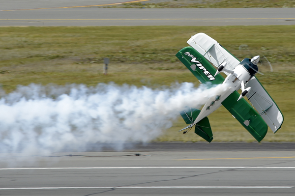 Jason Newburg flies his modified Pitts S25 known as the Viper during the Arctic Thunder Special Needs and Family Day at Joint Base Elmendorf-Richardson, Alaska on July 29, 2016. The biennial event is historically the largest multi-day event in the state and one of the premier aerial demonstrations in the world. Arctic Thunder will open its doors to the public, featuring more than 40 key performers and ground acts, July 30 and 31. (U.S. Air Force photo/Alejandro Pena)