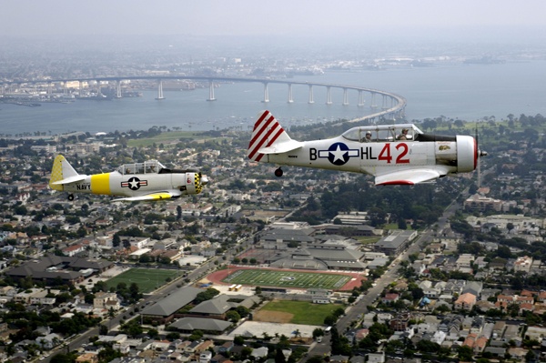 "061008-N-7286M-047 Coronado, Calif. (Oct. 8, 2006) - Vintage T-6 ""Texan"" aircraft conduct a formation flyover as part of the SRT Coronado Classic Speed Festival opening ceremonies held on Naval Base Coronado air strip. The SRT Coronado Classic Speed Festival featured over 200 classic racecars from around the world competing on a 1.6-mile course. Speed Fest, held Oct. 7-8, is one of the many events taking place during San Diego Fleet Week. U.S. Navy photo by Mass Communication Specialist 2nd Class Daniel R. Mennuto (RELEASED)"