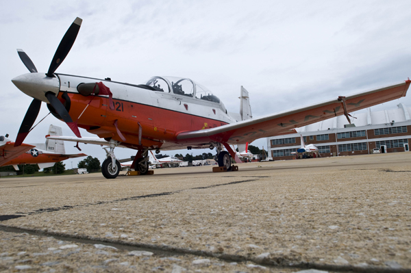 140924-N-OY799-058 PATUXENT RIVER, Md. (Sept. 24, 2014) A T-6B Texan aircraft is on the flight line at the U.S. Naval Test Pilot School at Naval Air Station Patuxent River. The school provides instruction to experienced pilots, flight officers and engineers in the processes and techniques of aircraft and systems test and evaluation. (U.S. Navy photo by Mass Communication Specialist 2nd Class Kenneth Abbate/Released)