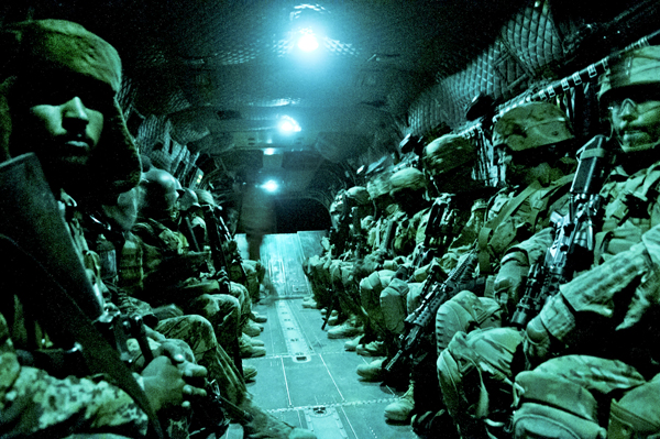 Paratroopers with the 82nd Airborne Division's 1st Brigade Combat Team and Afghan National Army soldiers with 6th Kandak, 203rd Corps, travel aboard a CH-47 Chinook heavy lift helicopter during an air assault mission May 4, 2012, Ghazni Province, Afghanistan. Afghan troops, who will eventually take over the security role, provide a cultural link for American troops. (U.S. Army photo by Sgt. Michael J. MacLeod)