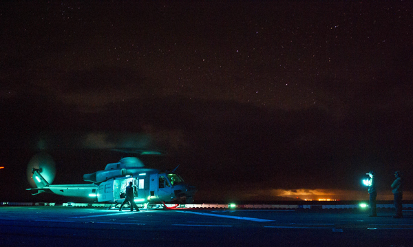 140724-N-AQ172-239 PACIFIC OCEAN (July 24, 2014) A UH-1Y Venom Huey helicopter conducts night flight operations aboard the amphibious assault ship USS Peleliu (LHA 5) during Rim of the Pacific (RIMPAC) Exercise 2014. Twenty-two nations, 49 ships and six submarines, more than 200 aircraft and 25,000 personnel are participating in RIMPAC exercise from June 26 to Aug. 1, in and around the Hawaiian Islands and Southern California. (U.S. Navy photo by Mass Communication Specialist 2nd Class Daniel Viramontes/Released)