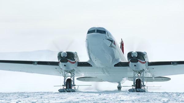 A turboprop powered DC-3 flown by Kenn Borek Air, Ltd. skiing on Antarctic ice (aircraft make a greater variety of research possible by being less limited by geographic or time constraints)—image provided by National Geographic