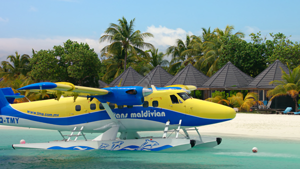 Twin Otter flown by Trans Maldivian before its sharp right turn followed by backing onto the beach where guests may have flown away from poor weather at home only the day prior—image provided by National Geographic
