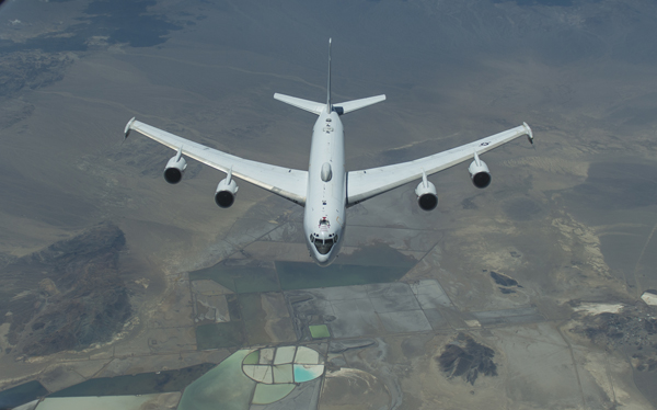 Aircrew members from the 9th Air Refueling Squadron, Travis AFB, California refuel a Navy E6 B Mercury somewhere over the Nevada California border, Aug. 5,2014. (Released - U.S. Air Force Photograph/Heide Couch)