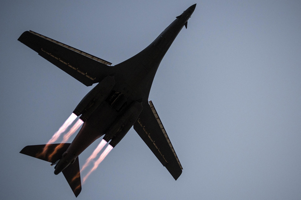 A B-1B Lancer takes off from Al Udeid Air Base, Qatar, to conduct combat operations April 8, 2015. Al Udeid AB is a strategic coalition base that supports over 90 combat and support aircraft and houses more than 5,000 military personnel. (U.S. Air Force photo/Senior Airman James Richardson)