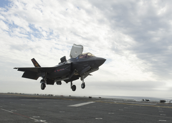 161028-N-AC237-144 PACIFIC OCEAN (Oct. 28, 2016) An F-35B Lightning II aircraft lands for the first time on the flight deck of amphibious assault ship USS America (LHA 6). The F-35B short takeoff/vertical landing (STOVL) variant is the world's first supersonic STOVL stealth aircraft. America, with Marine Operational Test and Evaluation Squadron 1 (VMX-1) and Air Test and Evaluation Squadron 23 (VX-23) embarked, is underway conducting the first phase of developmental testing for the F-35B Lightning II aircraft, which will evaluate the full spectrum of joint strike fighter measures of suitability and effectiveness in an at-sea environment. (U.S. Navy photo by Petty Officer 1st Class Benjamin Wooddy/Released)