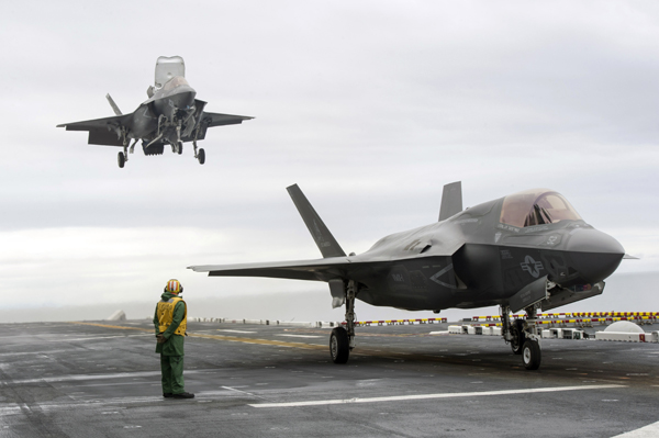 161030-N-VR008-169 PACIFIC OCEAN (Oct. 30, 2016) Two F-35B Lightning II aircraft land on the flight deck aboard the amphibious assault ship USS America (LHA 6). The F-35B short takeoff/vertical landing (STOVL) variant is the world's first supersonic STOVL stealth aircraft. America, with Marine Operational Test and Evaluation Squadron 1 (VMX-1), Marine Fighter Attack Squadron 211 (VMFA-211) and Air Test and Evaluation Squadron 23 (VX-23) embarked, are underway conducting operational testing and the third phase of developmental testing for the F-35B Lightning II aircraft, respectively. The tests will evaluate the full spectrum of joint strike fighter measures of suitability and effectiveness in an at-sea environment. (U.S. Navy photo by Petty Officer 3rd Class Kyle Goldberg/Released)