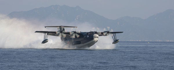 The Japan Maritime Self Defense Force executes the first training flights for calendar year 2014 aboard Marine Corps Air Station Iwakuni, Japan, Jan. 7, 2014. The flights included a water rescue mission where divers saved a simulated drowning man.