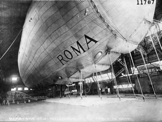 A semi-rigid airship, the Roma used hydrogen for lift, and a metal keel supported the bag. This photograph shows the metal keel being assembled. Afterward, the metal framework was covered with cloth, giving the Roma its characteristic fin along the bottom. (U.S. Air Force photo)
