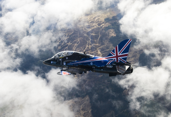 A specially painted Hawk T1 jet aircraft of the Royal Air Force's 208 Squadron, is pictured flying through the clouds over its home at RAF Valley in Wales. This particular aircraft is the diplay Hawk for 2009 that will be seen by many thousands of people throughout the summer season of aircraft displays across the UK. The underside of this Hawk is painted with the symbol of the RAF Benevolent Fund in celebration of the 90th anniversary of the organisation.