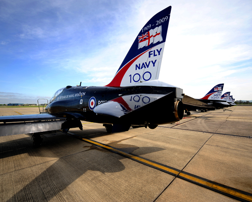 A line of Royal Navy Hawk trainer jets are pictured at RNAS Yeovilton sporting the livery of the 100th Anniversay of flying in the Royal Navy.