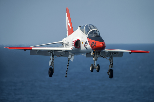 140711-N-ZG705-315 ATLANTIC OCEAN (July 11, 2014) A T-45C Goshawk assigned to the Tigers of Training Squadron (VT) 9 prepares to land on the flight deck of the aircraft carrier USS Harry S. Truman (CVN 75). Harry S. Truman is underway conducting carrier qualifications. (U.S. Navy photo by Mass Communication Specialist 3rd Class Karl Anderson/Released)
