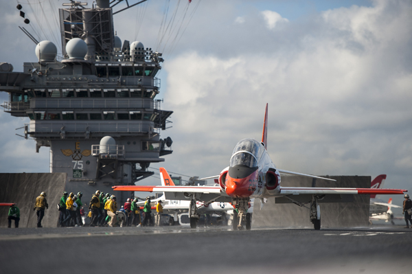 140930-N-NU281-395 ATLANTIC OCEAN (Sept. 30, 2014) A T-45C Goshawk training aircraft assigned to the Golden Eagles of Training Squadron (VT) 22 launches from the flight deck of the aircraft carrier USS Harry S. Truman (CVN 75). (U.S. Navy photo by Mass Communication Specialist Seaman Justin R. Pacheco/Released)