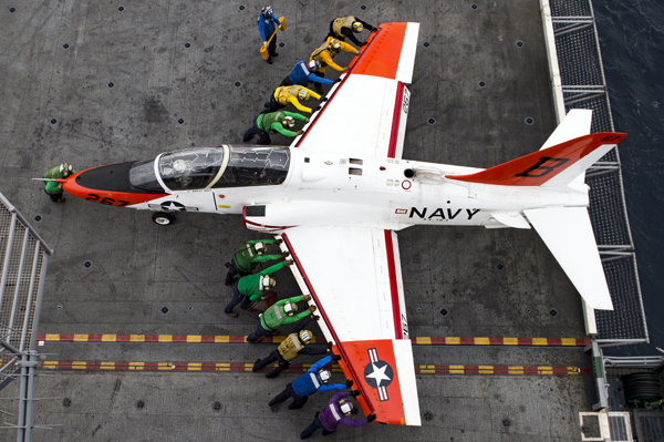 160205-N-KK394-300 ATLANTIC OCEAN (Feb. 5, 2016) - Sailors assist in moving a T-45C Goshawk assigned to Carrier Training Wing (CTW) 2 on the flight deck of the aircraft carrier USS Dwight D. Eisenhower (CVN 69). Dwight D. Eisenhower is currently underway preparing for the upcoming Board of Inspection and Survey (INSURV) and conducting carrier qualifications. (U.S. Navy photo by Mass Communication Specialist 3rd Class Anderson W. Branch/Released)
