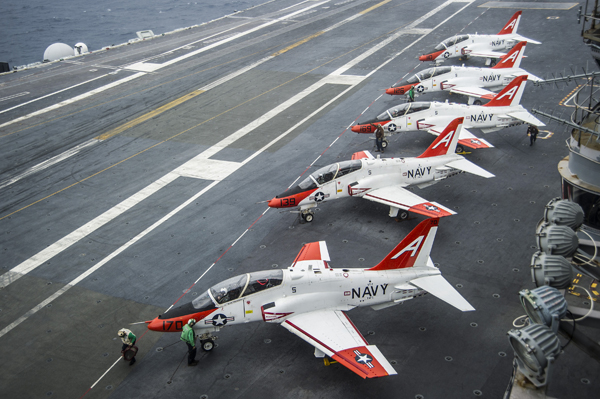 161210-N-EH855-008 ATLANTIC OCEAN (Dec. 10, 2016) Pilots perform pre-flight procedures in T-45C Goshawks from Training Air Wing One (TRAWING) 1 on the flight deck of the aircraft carrier USS George Washington (CVN 73). George Washington, homeported in Norfolk, is underway in the Atlantic Ocean. (U.S. Navy photo by Petty Officer 2nd Class Bryan Mai)