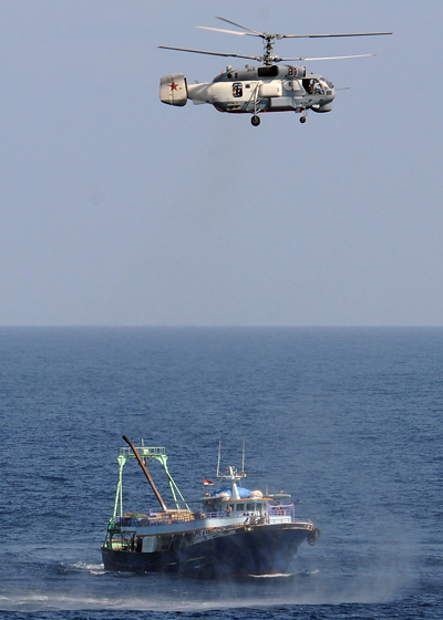 090209-N-1082Z-045 GULF OF ADEN (Feb. 9, 2009) A Russian Helix KA-27 helicopter assigned to the Russian destroyer Admiral Vinogradov (DDG 572) investigates a fishing trawler. The helicopter and Admiral Vinogradov are working with the guided-missile cruiser USS Vella Gulf (CG 72) while conducting operations in the Gulf of Aden. Vella Gulf is the flagship for Combined Task Force 151, a multi-national task force conducting counterpiracy operations to detect and deter piracy in and around the Gulf of Aden, Arabian Gulf, Indian Ocean and Red Sea. (U.S. Navy photo by Mass Communications Specialist 2nd Class Jason R. Zalasky/Released)