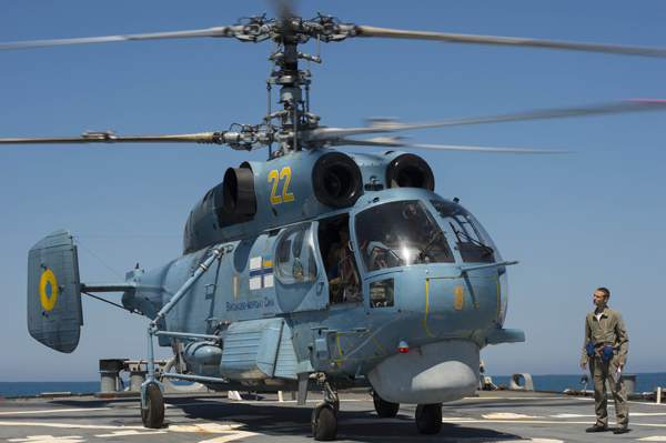 150602-N-FQ994-064 BLACK SEA (June 2, 2015) A Ukrainian Navy Helix 05 helicopter conducts flight operations aboard the guided-missile destroyer USS Ross (DDG 71) during a passing exercise. Ross is conducting naval operations in the U.S. 6th Fleet area of operations in support of U.S. national security interests in Europe. (U.S. Navy photo by Mass Communication Specialist 3rd Class Robert S. Price/Released)