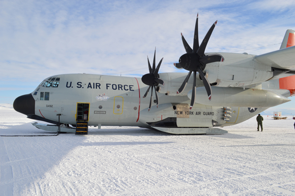 """An LC-130 """"Skibird"""" from the New York Air National Guard's 109th Airlift Wing in Scotia, New York, sits on the ice runway near McMurdo Station, Antarctica, Nov. 9, 2015. A total of seven 109th AW LC-130s are deployed this season and about 330 missions planned through the season which ends in February. This is the 28th season that the unit has participated in Operation Deep Freeze, the military component of the U.S. Antarctic Program, which is managed by the National Science Foundation. (U.S. Air National Guard photo by Capt. David S. Price/Released)"""