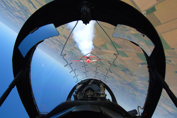 Red 10 & 11 of the RAF Aerobatic Team, The Red Arrows, practicing their manoeuvres over RAF Scampton, Lincoln. This picture shows the pilots view.
