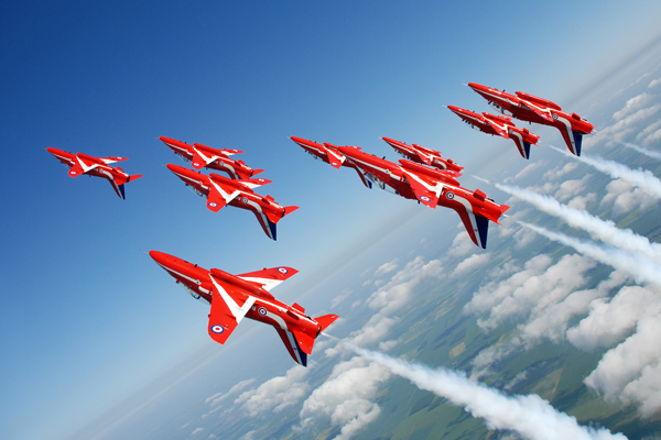 """The Royal Air Force Aerobatic Team (RAFAT), """"The Red Arrows"""" display over RAF Scampton, Lincoln."""