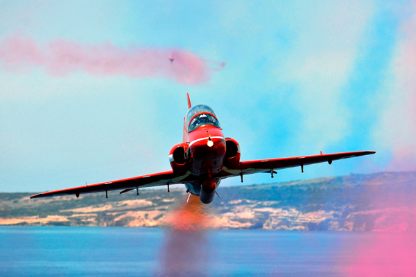 A Royal Air Force Red Arrows Hawk jet screams towards the photographer in this dramatic image. The Reds were practicing their 2009 summer season display at RAF Akrotiri in Cyprus.