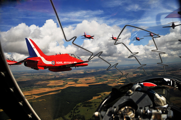 The Red Arrows are pictured flying over Scotland, taken from the cockpit of one of their aircraft. The Royal Air Force Hawk jet aircraft comprise the world famous RAF Aerobatic Team.