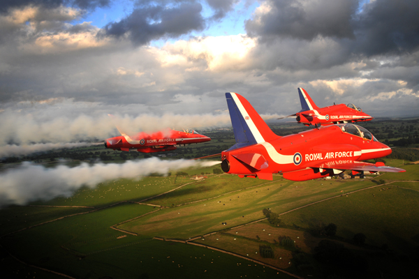 The Red Arrows are pictured flying over Scotland. The Royal Air Force Hawk jet aircraft comprise the world famous RAF Aerobatic Team.