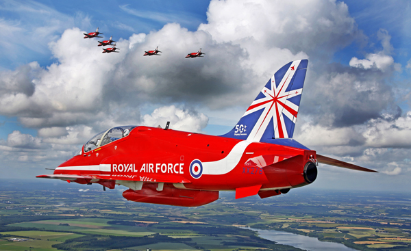 'Red 6' of the world famous air display team the Red Arrows is pictured during a transit flight from Denmark back to the UK, after a display at Gilze Rijen. In the background the front half of the 9 display aircraft can be seen in battle formation. This image was a winner in the 2014 RAF Photographic Competition.