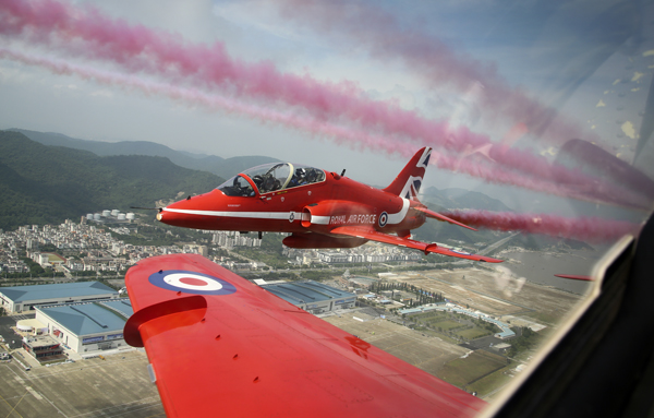 Pictured is part of the Red Arrows display tem flying over China. Aviation history was made by the Royal Air Force Aerobatic Team when the Red Arrows performed a public display in China for the first time. The show takes the number of countries in which the Red Arrows have performed to 57 since 1965 – the team's opening season.