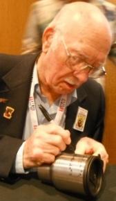 Ed Saylor signing memorabilia Gene Fioretti photo