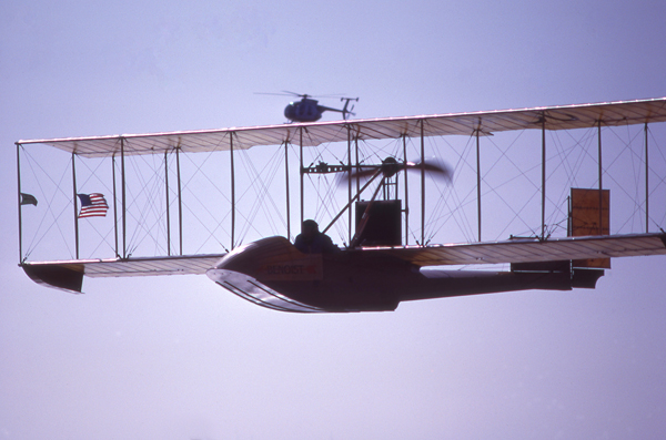 Hughes 500 chasing the replica Benoist XIV on 1 January 1984