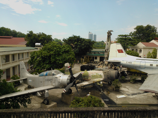 Douglas A-1E and Douglas A-1H Skyraiders at the Vietnam Military History Museum in Hanoi  — photo by Catherine Dowman ©2013