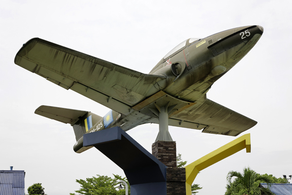 Pylon mounted Canadair CL 41G Tebuan at the monument honoring fallen Royal Malaysian Air Force avaitors — photo by Joseph May