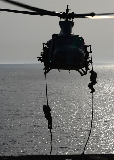 U.S. Marines practice fast roping onto the USS Bataa (LHD 5) from a UH-1Y Venom  — U.S. Navy photo by Mass Comm Spec 1st Class Julie Matyascik