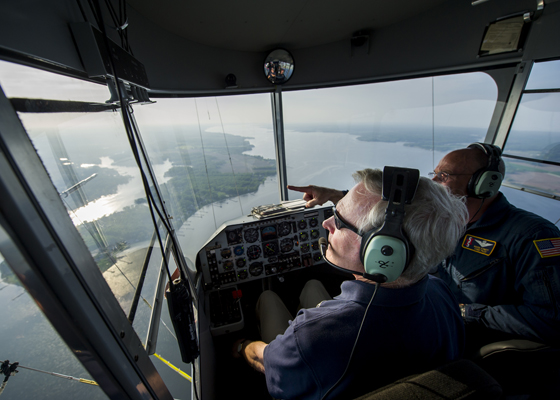 Secretary of the Navy Ray Mabus and airpship pilot Marty Chandler converse while aloft in the MZ-3A – U.S. Navy photo by Chief Mass Comm Spec Sam Shavers