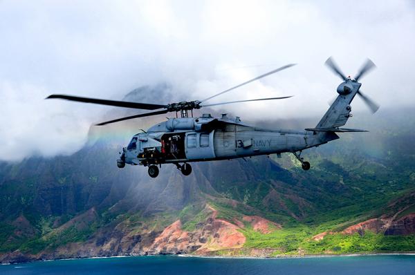 A UH-60 Sea Hawk of the Black Knights (Helicopter Sea Combat Squadron [HSC] 4 aboard the USS Ronald Reagan (CVN 76) coasts down the island of Kauai (Kaua'i in the Hawaiin language) — U.S. Navy photo by Ensign Joseph Pfaff