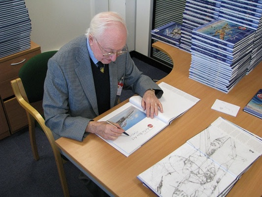 Aviation artist Roy Cross at a book signing for his The Vintage Years of Airfix Box Art — © Air Show Consultants:Ross Sharp