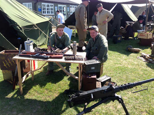 "Reenactors with a Thompson 0.45"" caliber machine gun ""Tommy Gun"" and Browning 0.50"""