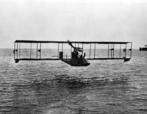 Triumphant pilot Tony Jannus waves as he lands in Tampa on the first leg of the first regularly-scheduled airline flight in 1914 — State Archives of Florida photo