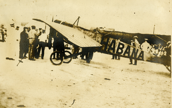 Domingo Rosillo standing by the X with his plane in Key West 1913.  Dewey Riggs Collection.