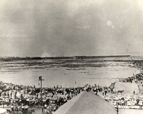 Domingo Rosillo plane leaving the airfied at Trumbo Point on May 17, 1913 fro the first flight to Cuba. The plane is a small dot. From the Monroe County Library Collection.